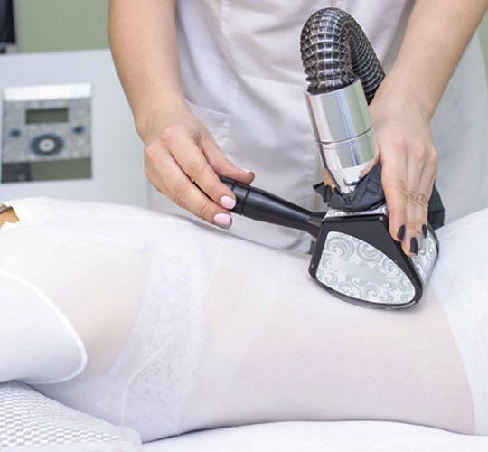girl body massage spa girl is given hardware massage she is wearing special jumpsuit massage cavitation cellulite fat loss 170532 1013 540x500 - لاغری - ماساژ لاغری