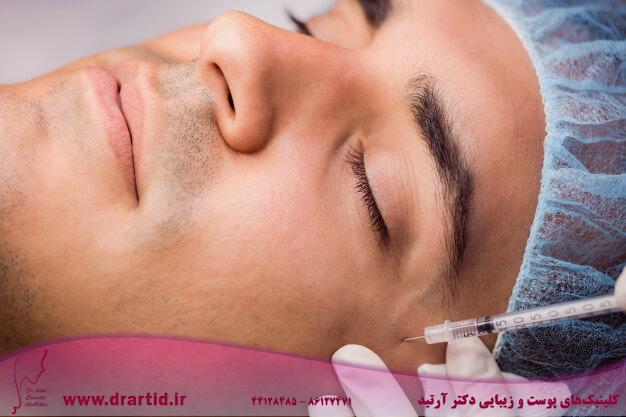 man receiving botox injection his face 107420 65188 - تزریق - بوتاکس
