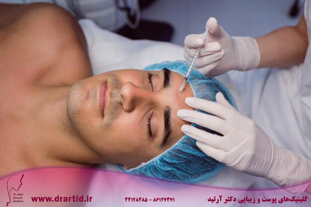 man receiving botox injection his forehead 107420 65181 - تزریق - بوتاکس