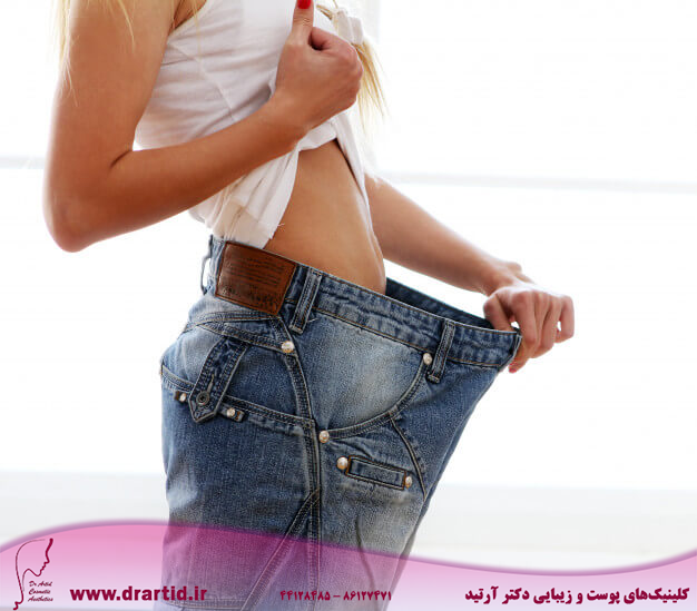 woman wearing jeans after weight loss 144627 24191 1 - لاغری