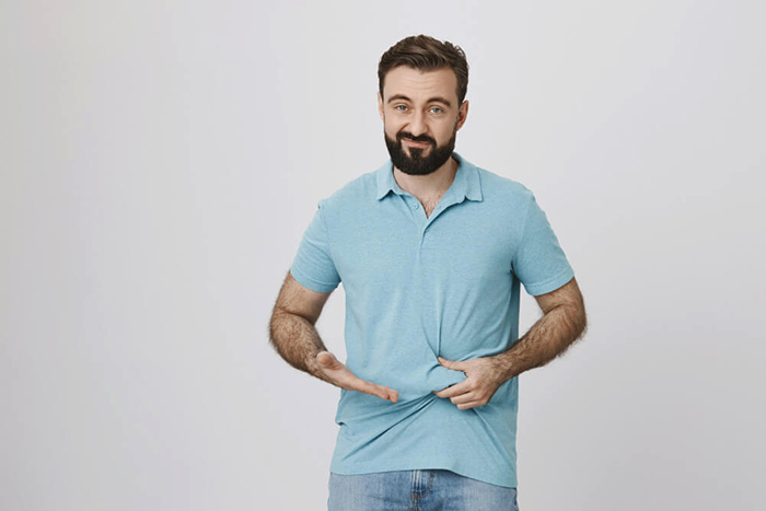 disappointed guy need lose weight showing fat belly - مقالات